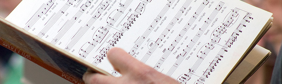 Open song book with musical notes